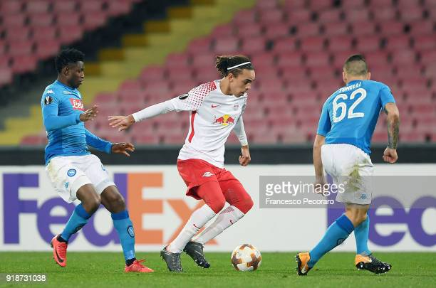 Players of SSC Napoli Amadou Diawara and Lorenzo Tonelli vies with RB Leipzig player Yussuf Poulsen during UEFA Europa League Round of 32 match...