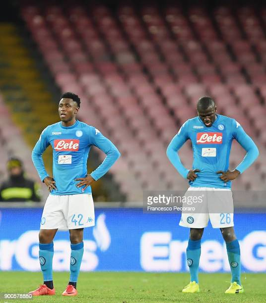 Players of SSC Napoli Amadou Diawara Kalidou Koulibaly stand disappointed after the 02 goal scored by Papu Gomez during the TIM Cup match between SSC...