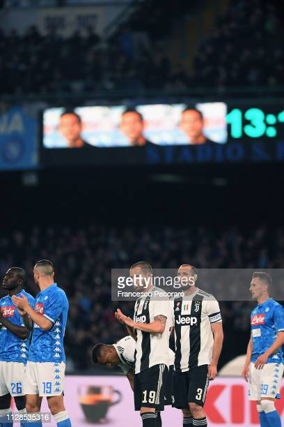 Players of SSC Napoli and Juventus commemorate Davide Astori at minute 13 during the Serie A match between SSC Napoli and Juventus at Stadio San...