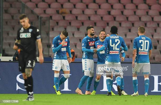 Players of SSC Napoli celebrate after Dries Mertens scored the 20 goal beside the disappointment of Giovanni Di Lorenzo of Empoli during the Serie A...