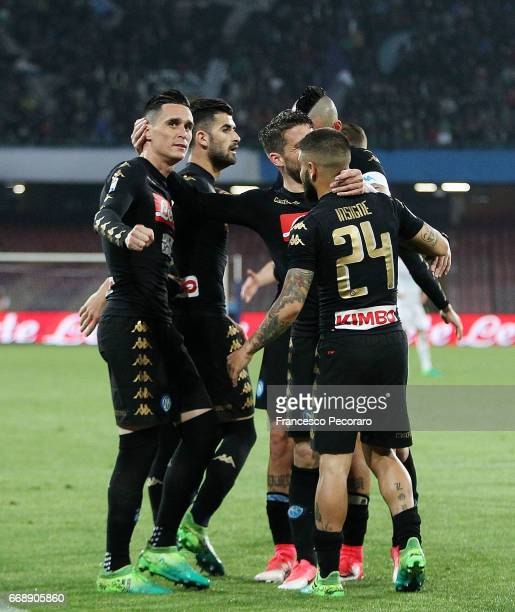 Players of SSC Napoli celebrate after the 30 scored by Jose Callejon during the Serie A match between SSC Napoli and Udinese Calcio at Stadio San...