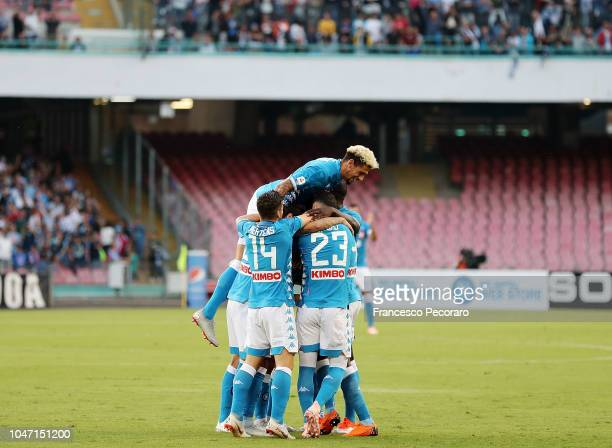 Players of SSC Napoli celebrate the 10 goal scored by Adam Ounas during the Serie A match between SSC Napoli and US Sassuolo at Stadio San Paolo on...