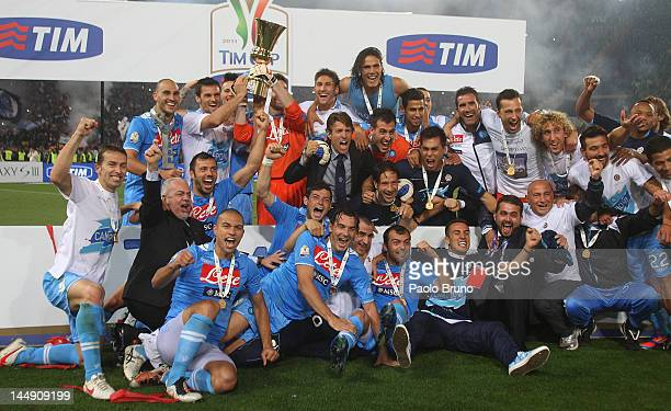 Players of SSC Napoli celebrate with the trophy after winning the Tim Cup final match against Juventus FC at Olimpico Stadium on May 20, 2012 in...