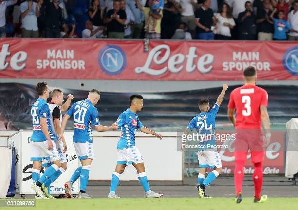 Players of SSC Napoli celebrates the 10 goal scored by Lorenzo Insigne beside the disappointment of Cristiano Biraghi of ACF Fiorentina during the...
