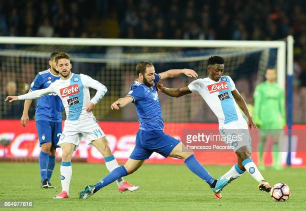 Players of SSC Napoli Dries Mertens and Amadou Diawara vies with Juventus FC player Gonzalo Higuain during the TIM Cup match between SSC Napoli and...