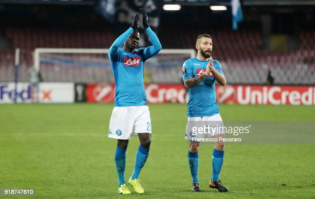Players of SSC Napoli Kalidou Koulibaly and Lorenzo Tonelli show their disappointment after UEFA Europa League Round of 32 match between Napoli and...