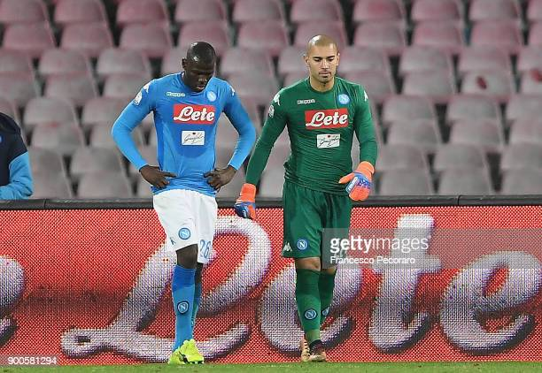 Players of SSC Napoli Kalidou Koulibaly Luigi Sepe stand disappointed after the 02 goal scored by Papu Gomez during the TIM Cup match between SSC...