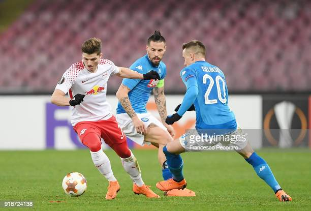 Players of SSC Napoli Marek Hamsik and Piotr Zielinski vies with RB Leipzig player Marcel Sabitzer during UEFA Europa League Round of 32 match...