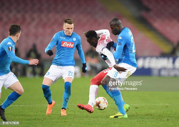 Players of SSC Napoli Piotr Zielinski and Kalidou Koulibaly vies with RB Leipzig player JeanKevin Augustin during UEFA Europa League Round of 32...