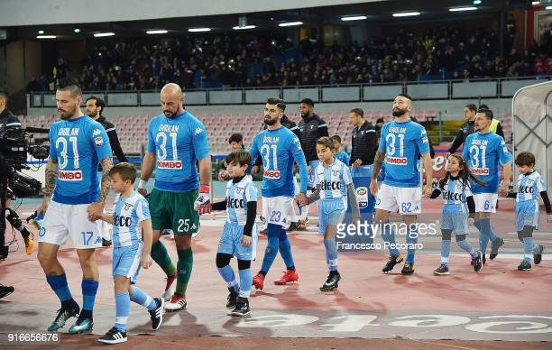 Players of SSC Napoli with the shirt of their injured teammate Faouzi Ghoulam before the serie A match between SSC Napoli and SS Lazio at Stadio San...