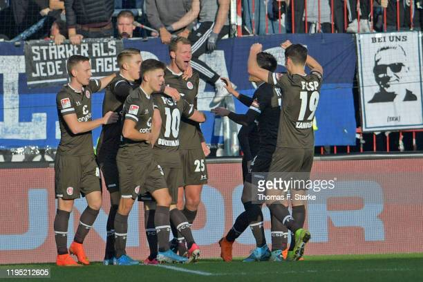 Players of St. Pauli celebrate their teams second goal with Henk Veerman during the Second Bundesliga match between FC St. Pauli and DSC Arminia...