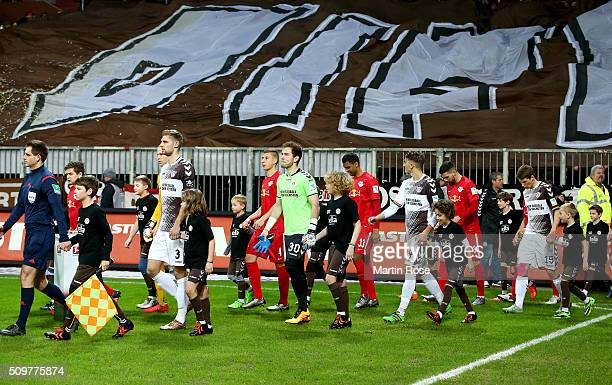 Players of St Pauli walk onto the pitch during the second Bundesliga match between FC St Pauli and RB Leipzig at Millerntor Stadium on February 12...
