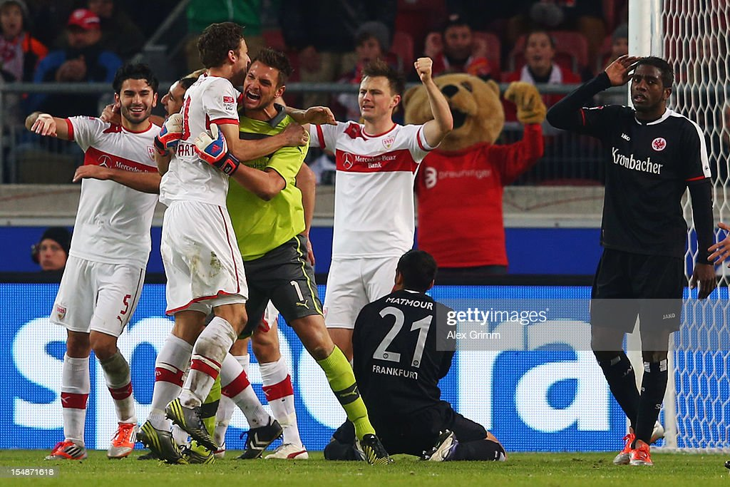 Players of Stuttgart celebrate as Karim Matmour (bottom) and Olivier Occean (R) react after the final whistle of the Bundesliga match between VfB Stuttgart and Eintracht Frankfurt at Mercedes-Benz Arena on October 28, 2012 in Stuttgart, Germany.