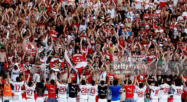 Players of Stuttgart celebrate with their supporters after the Bundesliga Match between VfB Stuttgart and SC Freiburg at the MercedesBenz Arena on...