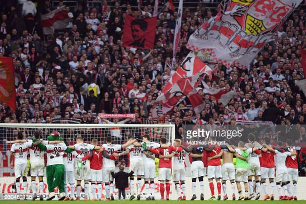 Players of Stuttgart stand in front of the fans after the Bundesliga match between VfB Stuttgart and RB Leipzig at MercedesBenz Arena on March 11...