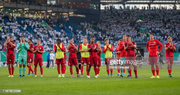 Players of Stuttgart wave to their fans after winning the DFB Cup first round match between Hansa Rostock and VfB Stuttgart at Ostseestadion on...