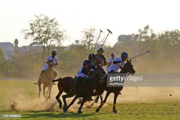 Players of Sujan Polo and Chandna Group teams in action during the 'Rajmata Gayatri Devi Memorial Cup' polo match at Polo ground in...