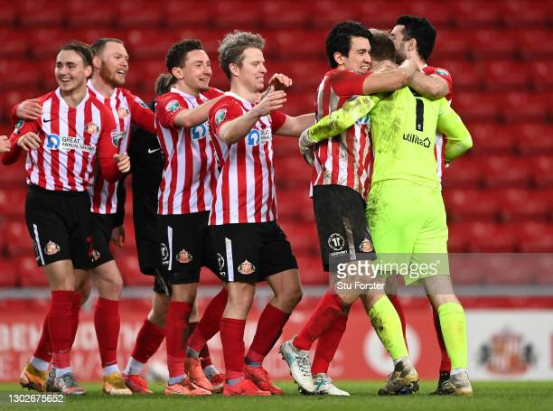 Players of Sunderland congratulate Lee Burge of Sunderland after winning the penalty shoot out during the Papa John's Trophy Semi-Final match between...