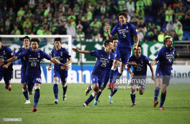 Players of Suwon Samsung Bluewings celebrate in the penalty shootout during the AFC Champions League Quarter Final second leg match between Suwon...