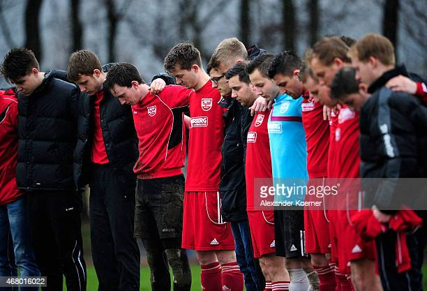 Players of SV Weetzen commemorate over the loss of midfielder Dennie G prior the eighth division of German football league game between SV Weetzen...