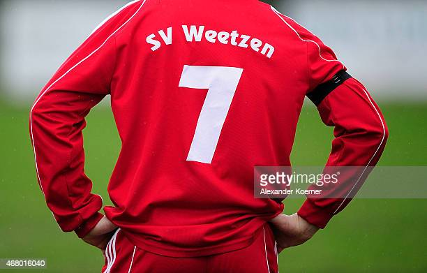 Players of SV Weetzen commemorate over the loss of midfielder Dennie G. Prior the eighth division of German football league game between SV Weetzen...