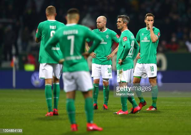 Players of SV Werder Bremen look dejected following the Bundesliga match between SV Werder Bremen and 1 FC Union Berlin at Wohninvest Weserstadion on...