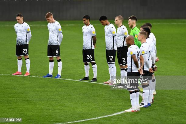 Players of Swansea City take part in a minutes silence during the Sky Bet Championship match between Swansea City and Cardiff City at the Liberty...