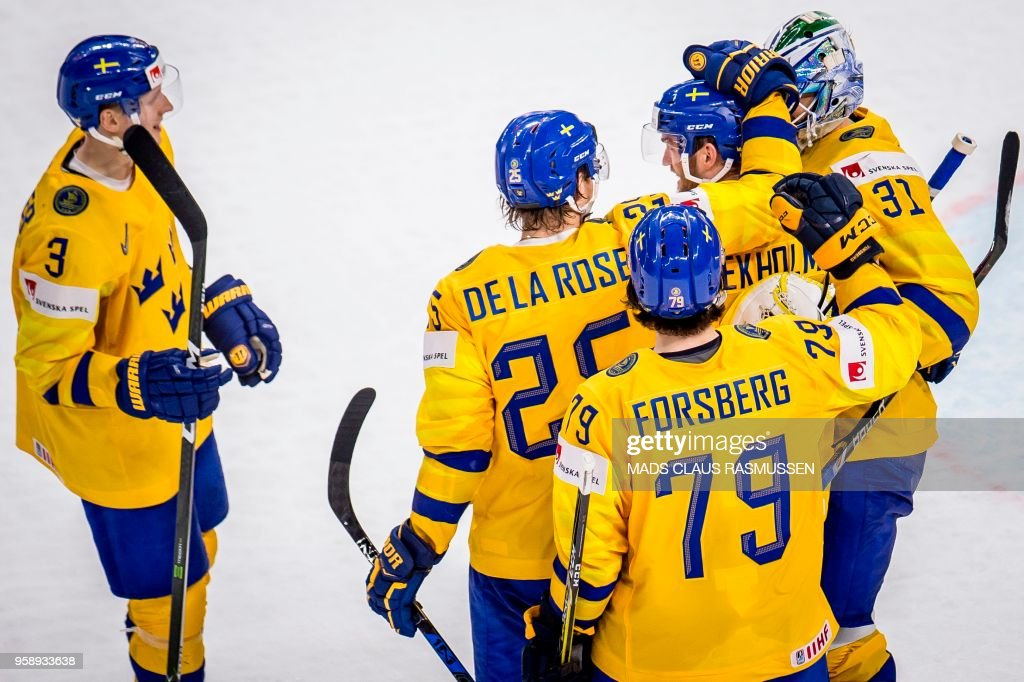 Players of Sweden celebrate after scoring during the IIHF World Championship group A ice hockey match between Russia and Sweden in Royal Arena in Copenhagen, on May 15, 2018. (Photo by Mads Claus Rasmussen / Ritzau Scanpix / AFP) / Denmark OUT