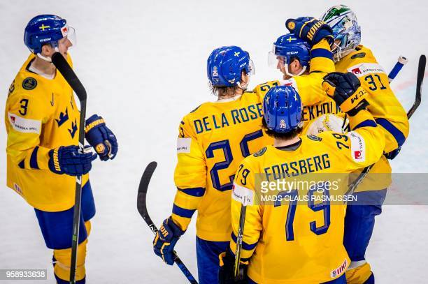 Players of Sweden celebrate after scoring during the IIHF World Championship group A ice hockey match between Russia and Sweden in Royal Arena in...
