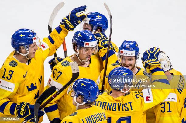 TOPSHOT Players of Sweden celebrates after the IIHF World Championship group A ice hockey match between Russia and Sweden in Royal Arena in...