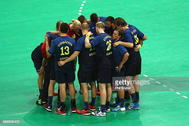Players of Sweden huddle after the Men's Preliminary Group B match between Sweden and Germany at on Day 2 of the Rio 2016 Olympic Games at the Future...