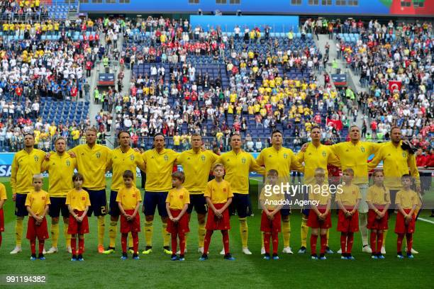 Players of Sweden line up for the ceremony ahead of the 2018 FIFA World Cup Russia Round of 16 match between Sweden and Switzerland at the Saint...