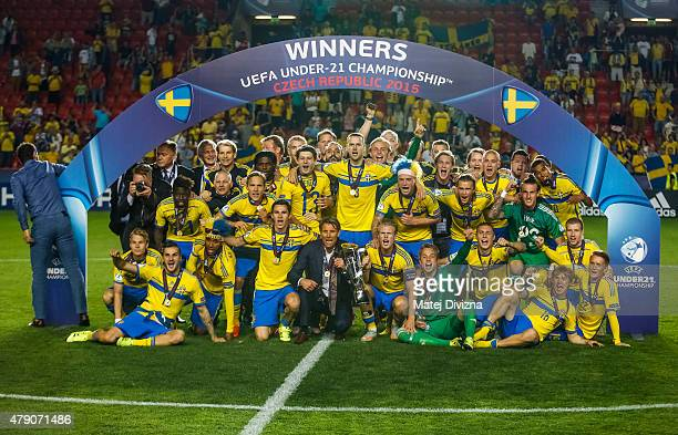 Players of Sweden pose as they celebrate their victory in UEFA U21 European Championship final match between Portugal and Sweden at Eden Stadium on...