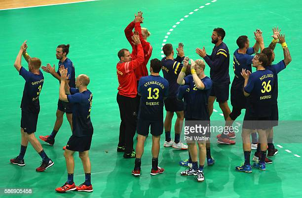 Players of Sweden wave to the fans after the Men's Preliminary Group B match between Sweden and Germany at on Day 2 of the Rio 2016 Olympic Games at...