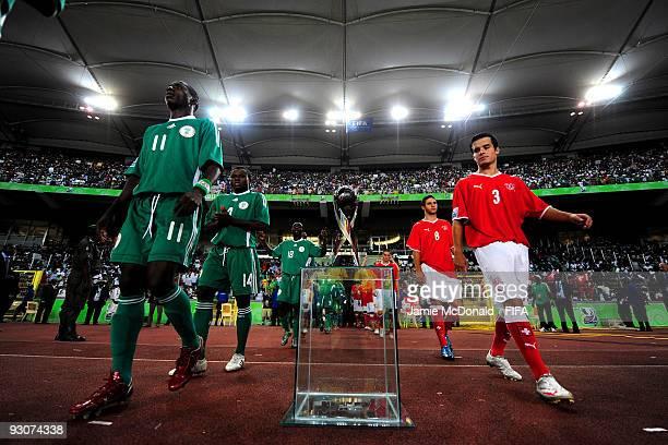 Players of Switzerland and Nigeria walk past the FIFA U17 World Cup during the FIFA U17 World Cup Final match between Switzerland and Nigeria at the...