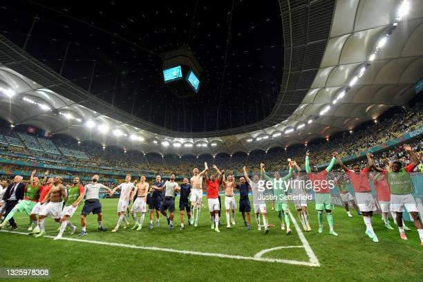 Players of Switzerland celebrate after victory in the penalty shoot out following the UEFA Euro 2020 Championship Round of 16 match between France...