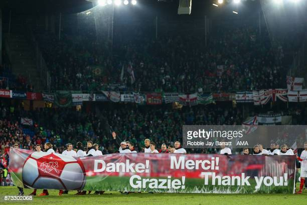 Players of Switzerland hold up a message to the fans saying thank you at full time during the FIFA 2018 World Cup Qualifier PlayOff Second Leg...