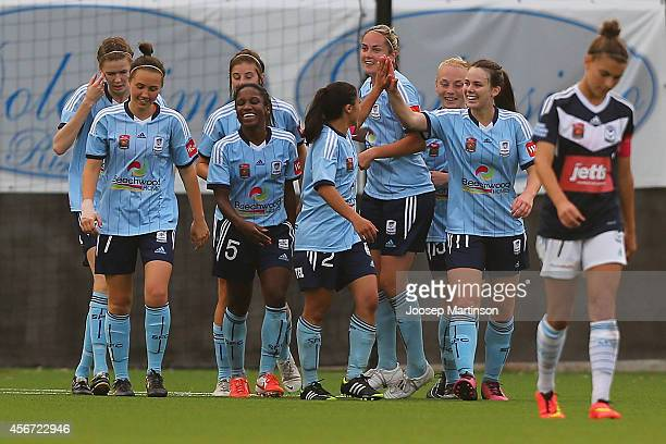 Players of Sydney FC celebrate a goal by Jasmyne Spencer during the round four WLeague match between Sydney and Melbourne at Lambert Park on October...