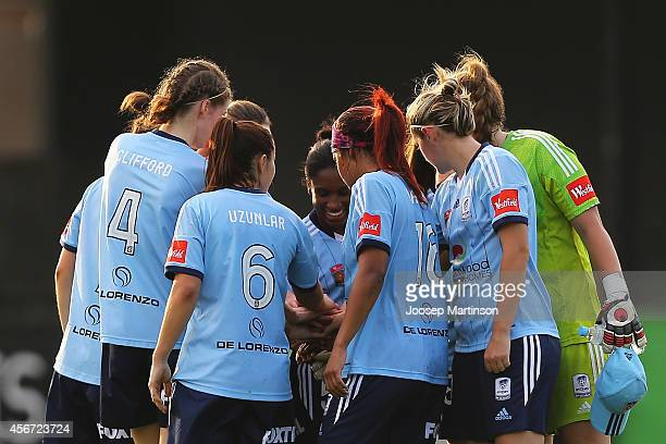 Players of Sydney FC huddle prior to the round four WLeague match between Sydney and Melbourne at Lambert Park on October 6 2014 in Sydney Australia