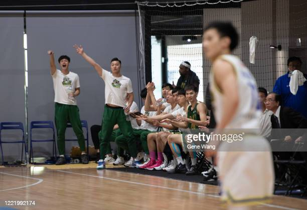 Players of Taiwan Beer cheer up at the court side during the SBL Finals Game Six between Taiwan Beer and Yulon Luxgen Dinos at Hao Yu Trainning...