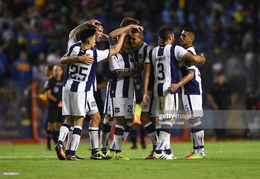 Players of Talleres celebrate after winning a match between Boca Juniors and Talleres as part of Torneo Primera Division 2016/17 at Alberto J Armando Stadium on March 12, 2017 in Buenos Aires, Argentina.