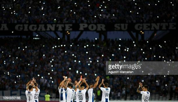 Players of Talleres wave the fans before a second stage first leg play-off match between Talleres and Sao Paulo as part of Copa CONMEBOL Libertadores...