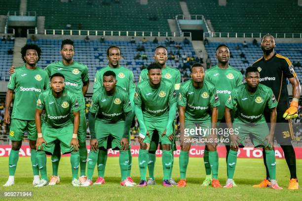 Players of Tanzanias Young Africans pose before their group match of CAF Confederations Cup against Rwandas Rayon Sports at National Stadium in Dar...