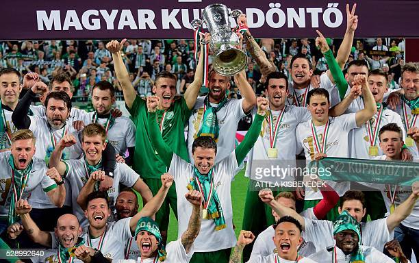 Players of TC Frerencvaros celebrate with the trophy after the Hungarian Cup final football match against FC Ujpest at the Groupama Arena in Budapest...