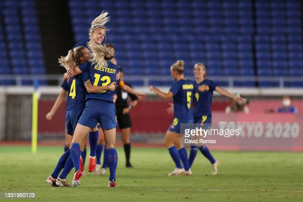 Players of Team Australia celebrate their side's victory after the Women's Semi-Final match between Australia and Sweden on day ten of the Tokyo 2020...