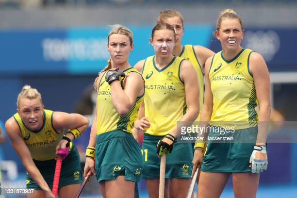 Players of Team Australia look on during the Women's Quarterfinal match between Australia and India on day ten of the Tokyo 2020 Olympic Games at Oi...