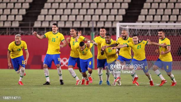 Players of Team Brazil celebrate their side's winning penalty in the penalty shoot out by Reinier of Team Brazil during the Men's Football Semi-final...