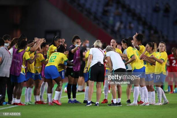 Players of Team Brazil show encouragement before the start of extra time during the Women's Quarter Final match between Canada and Brazil on day...