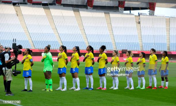 Players of Team Brazil stand for the national anthem prior to the Women's First Round Group F match between China and Brazil during the Tokyo 2020...