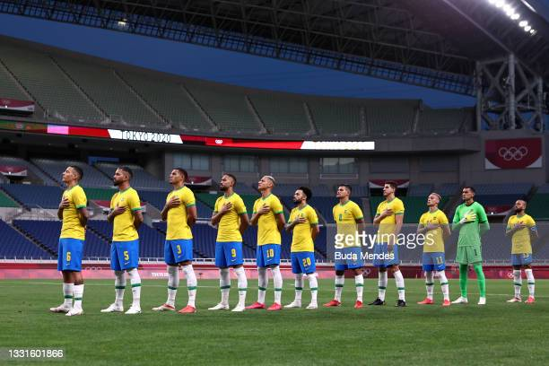 Players of Team Brazil stand for the national anthem prior to the Men's Quarter Final between Brazil and Egypt on day eight of the Tokyo Olympic...